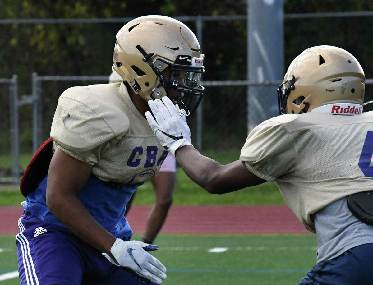 Christian Brothers Academy running back/middle linebacker Jaylen Riggins, left, works his position during a practice session on Wednesday, Oct. 6, 2021, at CBA in Colonie, N.Y.