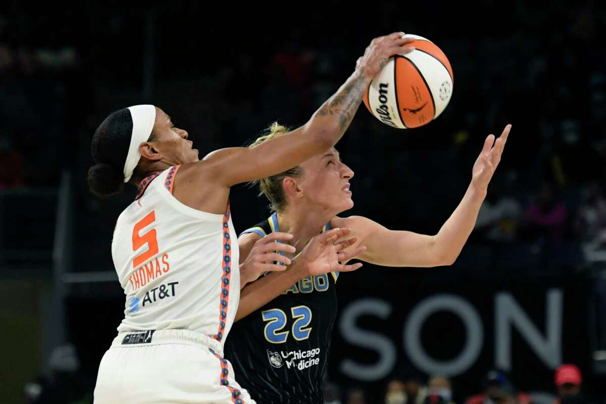 Chicago's Courtney Vandersloot (22) and Connecticut's Jasmine Thomas (5) reach for the ball Wednesday.