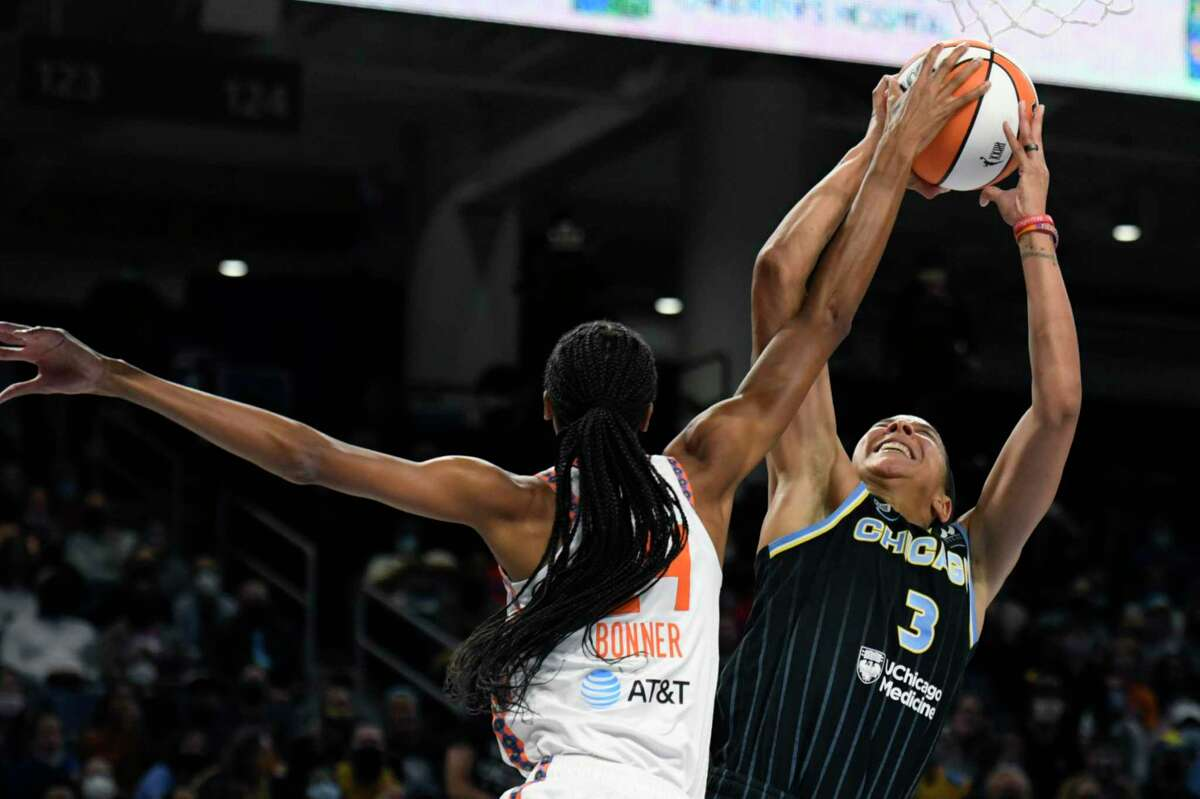 Chicago Sky's Candice Parker (3) shoots while being fouled by Connecticut Sun's DeWanna Bonner during the first half of Game 4 of a WNBA basketball playoff semifinal on Wednesday in Chicago.