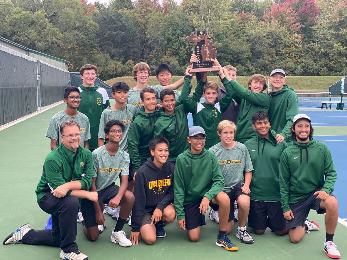 Dow High's boys' tennis team poses with the championship trophy after winning every flight at the Division 2 regional held Wednesday at the Greater Midland Tennis Center.