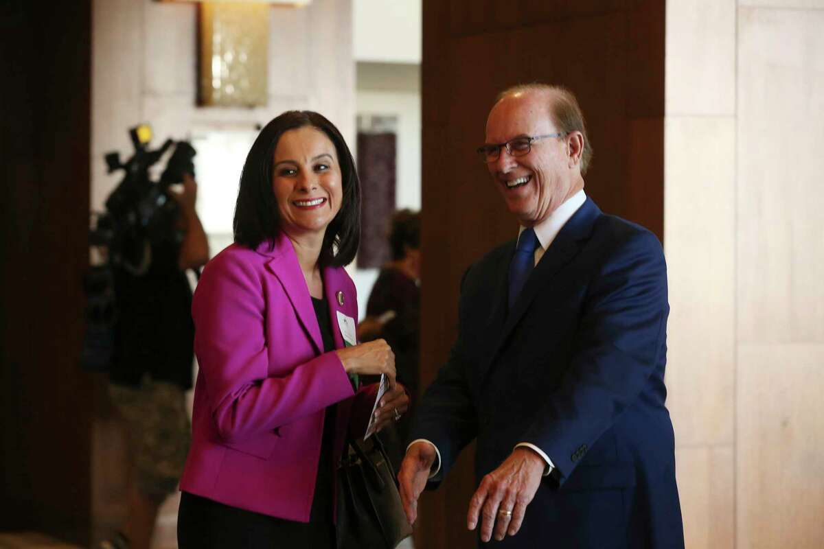 Bexar County Judge Nelson Wolff talks with Texas State Representative Ina Minjarez, (D-San Antonio), before giving his State of the County address at a San Antonio Chamber of Commerce luncheon at the Grand Hyatt Monday, Oct. 23, 2017.