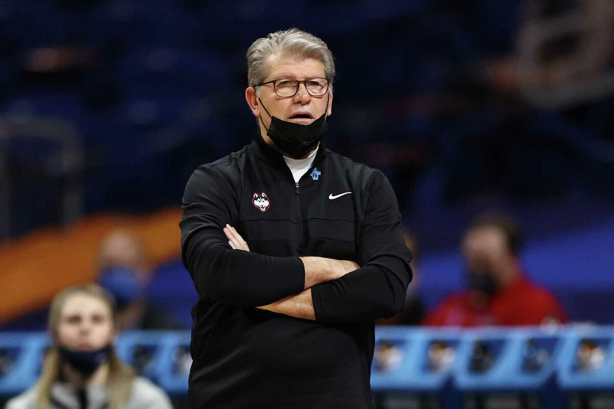 SAN ANTONIO, TEXAS - APRIL 02: Head coach Geno Auriemma of the UConn Huskies looks on against the Arizona Wildcats during the second quarter in the Final Four semifinal game of the 2021 NCAA Women's Basketball Tournament at the Alamodome on April 02, 2021 in San Antonio, Texas. (Photo by Elsa/Getty Images)