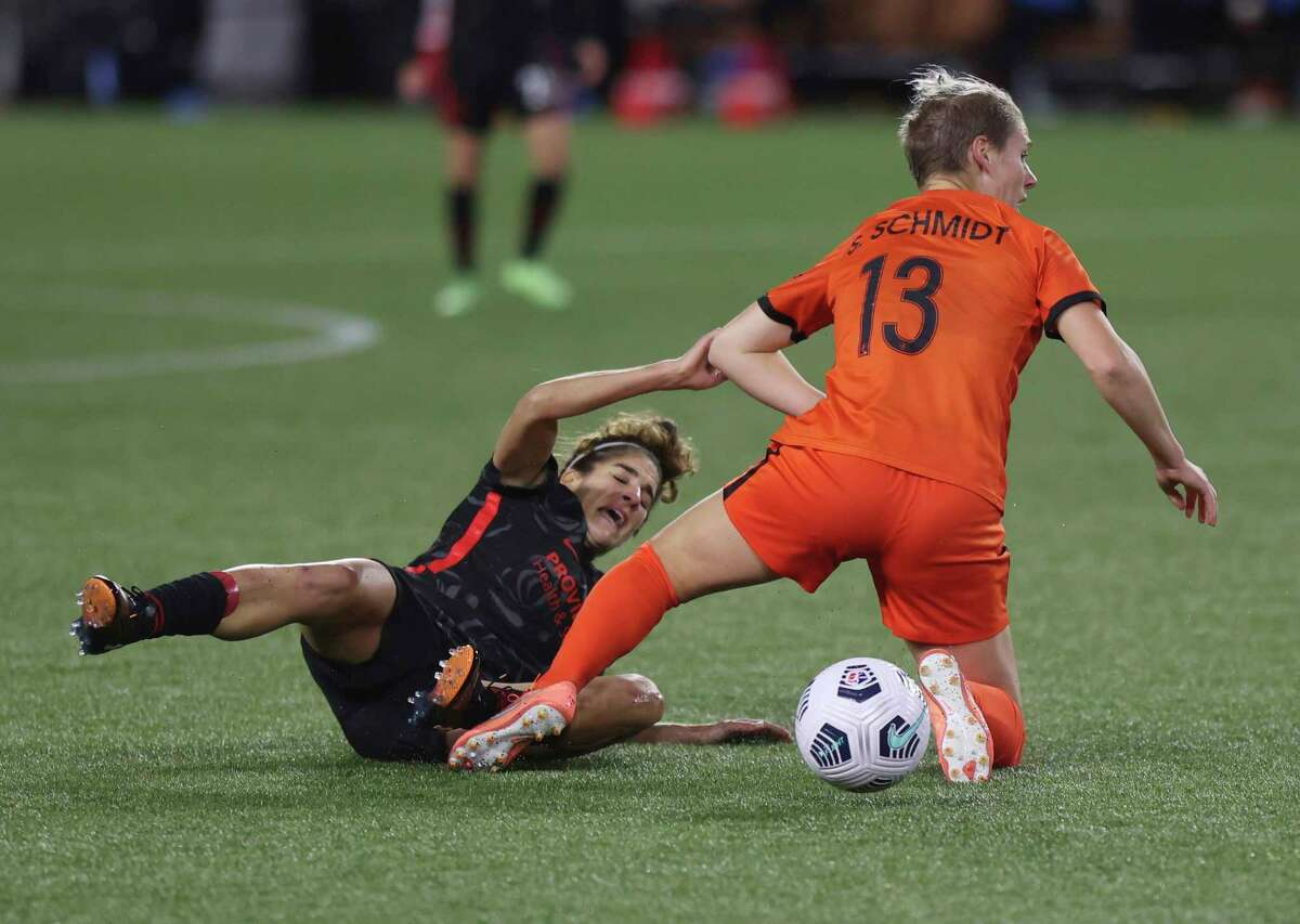 Portland Thorns midfielder Angela Salem, left, and Houston Dash midfielder Sophie Schmidt battle for the ball during the second half of an NWSL match Wednesday in Portland, Ore.