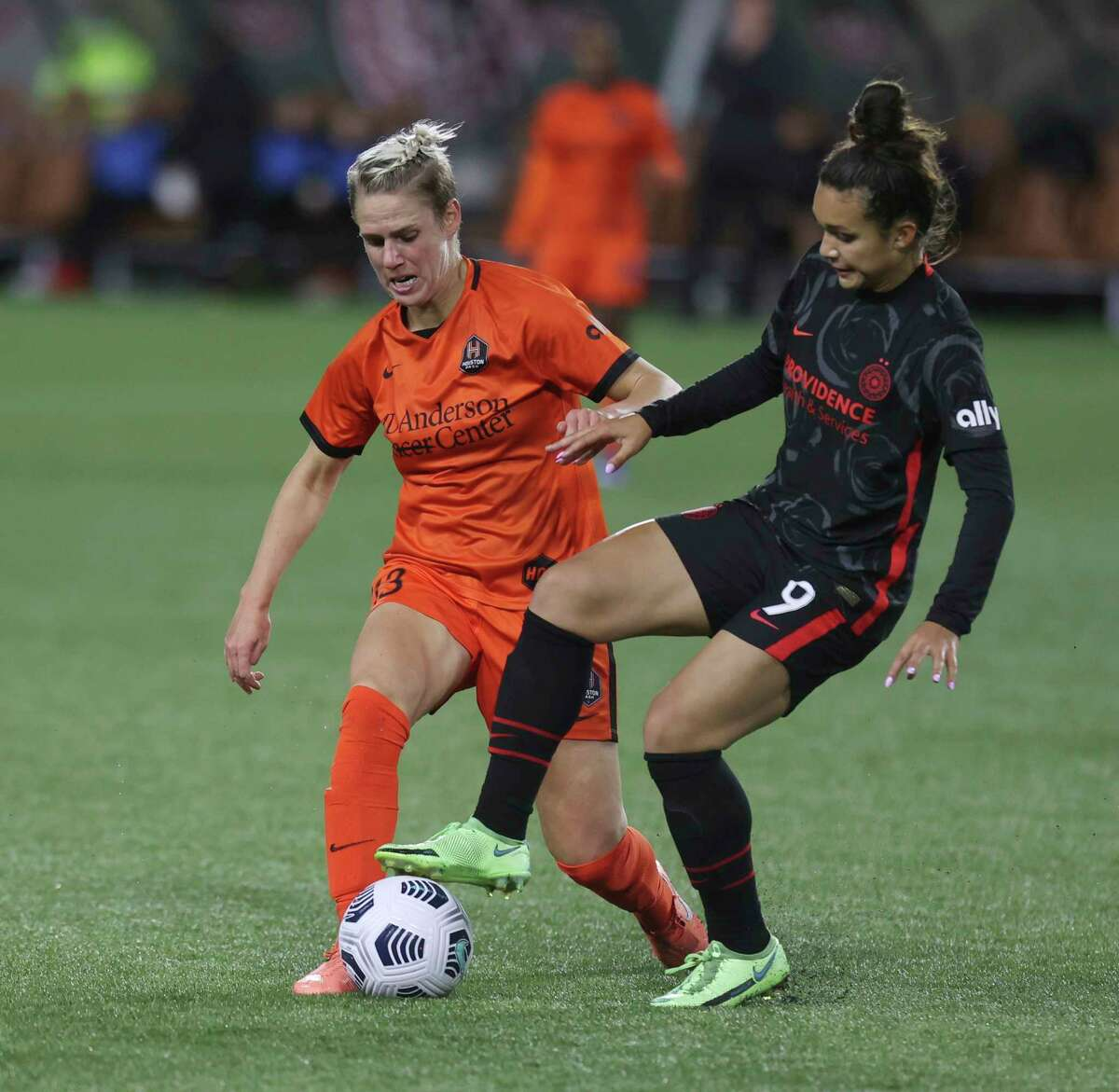 Portland Thorns forward Sophia Smith, right, and Houston Dash midfielder Sophie Schmidt compete for the ball during the second half of an NWSL match Wednesday in Portland, Ore.