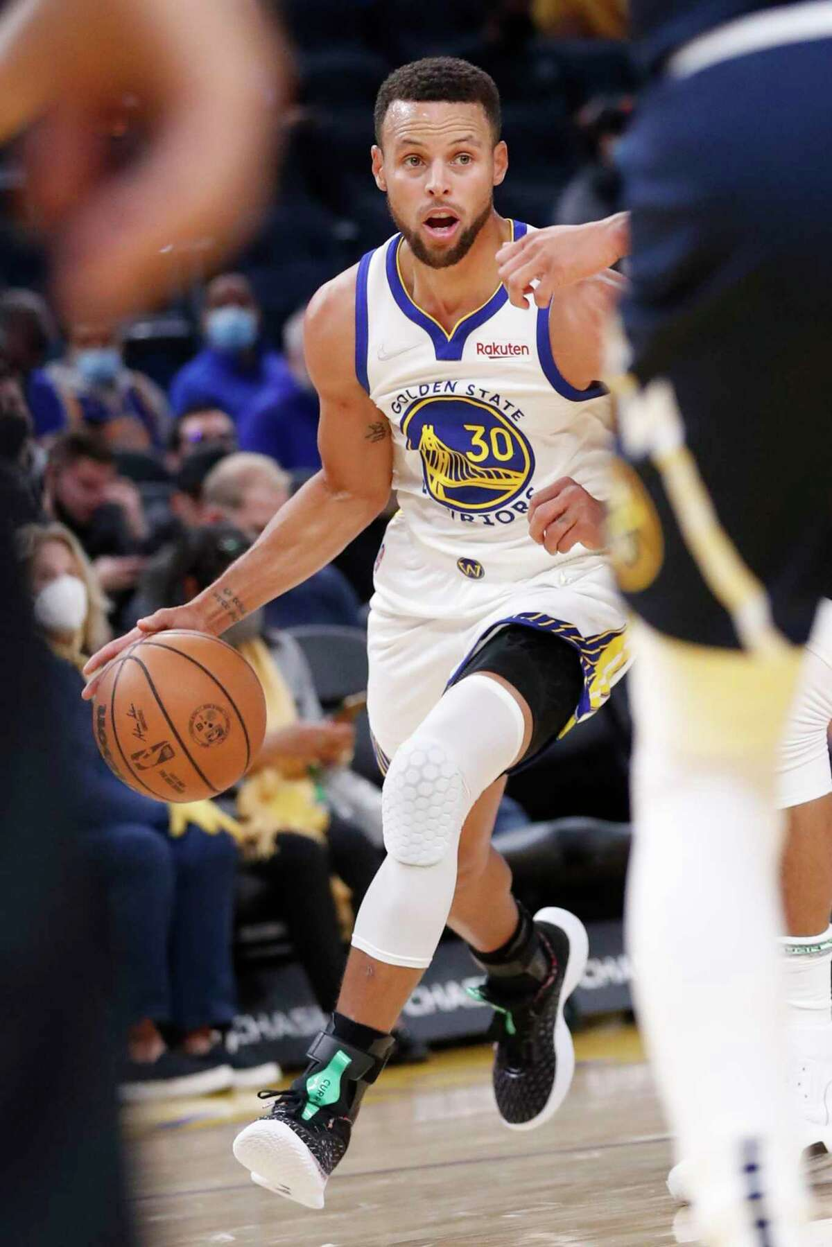 Golden State Warriors' Stephen Curry drives to the basket against Denver Nuggets in 1st quarter during NBA preseason game at Chase Center in San Francisco, Calif., on Wednesday, October 6, 2021.