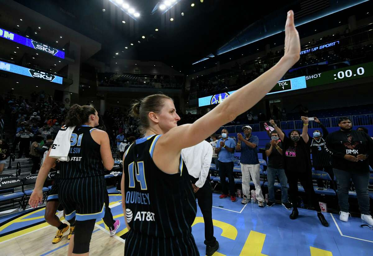 Chicago Sky's Allie Quigley (14) waves to the crowd after the Sky defeated the Connecticut Sun 86-83 in Game 3 of a WNBA semifinal playoff basketball game Sunday, Oct. 3, 2021, in Chicago. (AP Photo/Paul Beaty)