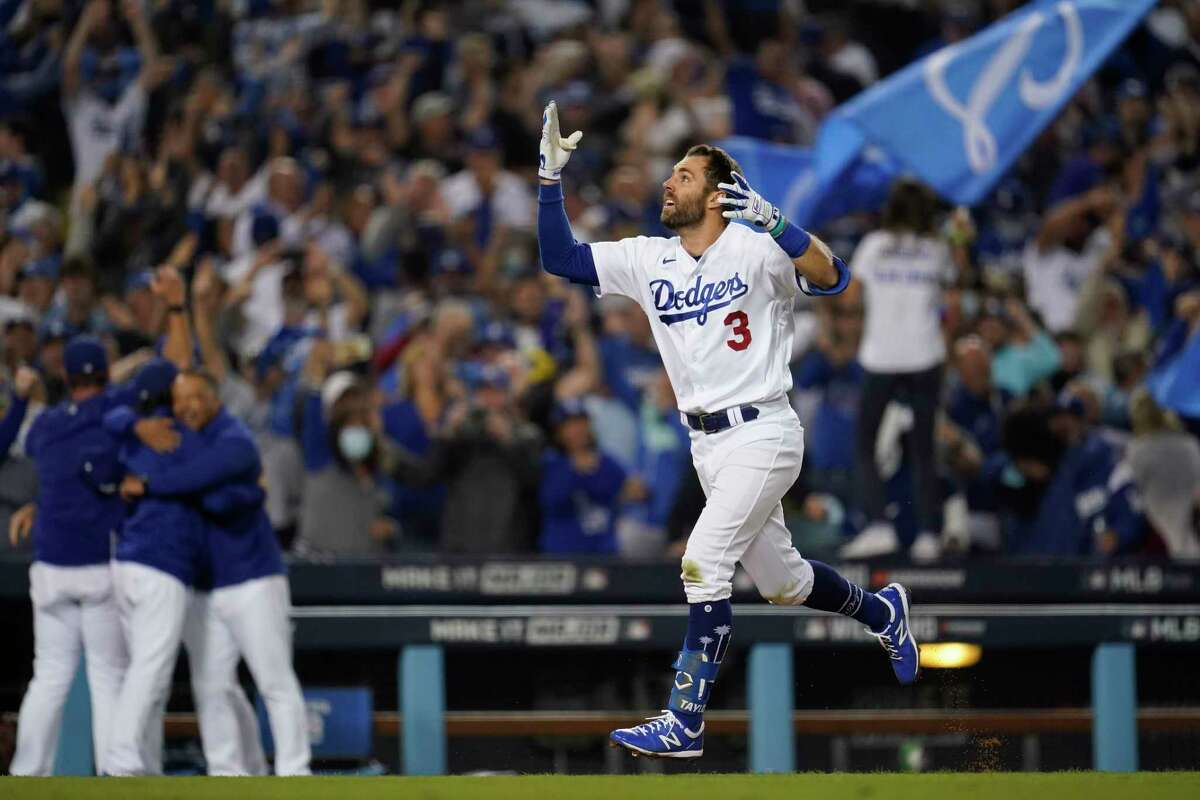 Los Angeles Dodgers' Chris Taylor (3) celebrates as he runs the bases after hitting a home run during the ninth inning to win a National League Wild Card playoff baseball game 3-1 over the St. Louis Cardinals Wednesday, Oct. 6, 2021, in Los Angeles. Cody Bellinger also scored. (AP Photo/Marcio Jose Sanchez)