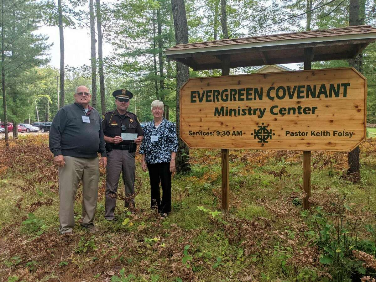 Lake County sheriff Rich Martin presents a check for $1,000 to Evergreen Covenant Church as part of the ongoing Sheriff's Charitable Campaign. (Submitted photo)