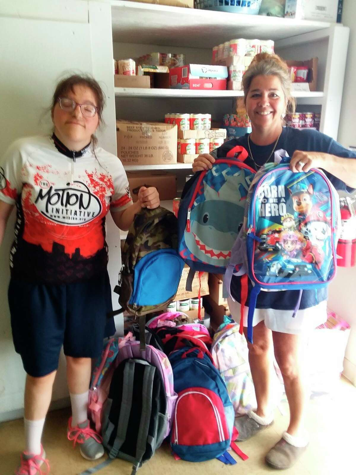 For the last two years, Alicia and Renae Walker have donated book bags filled with school supplies to the Bread of Life Pantry in Baldwin. (Submitted photo)