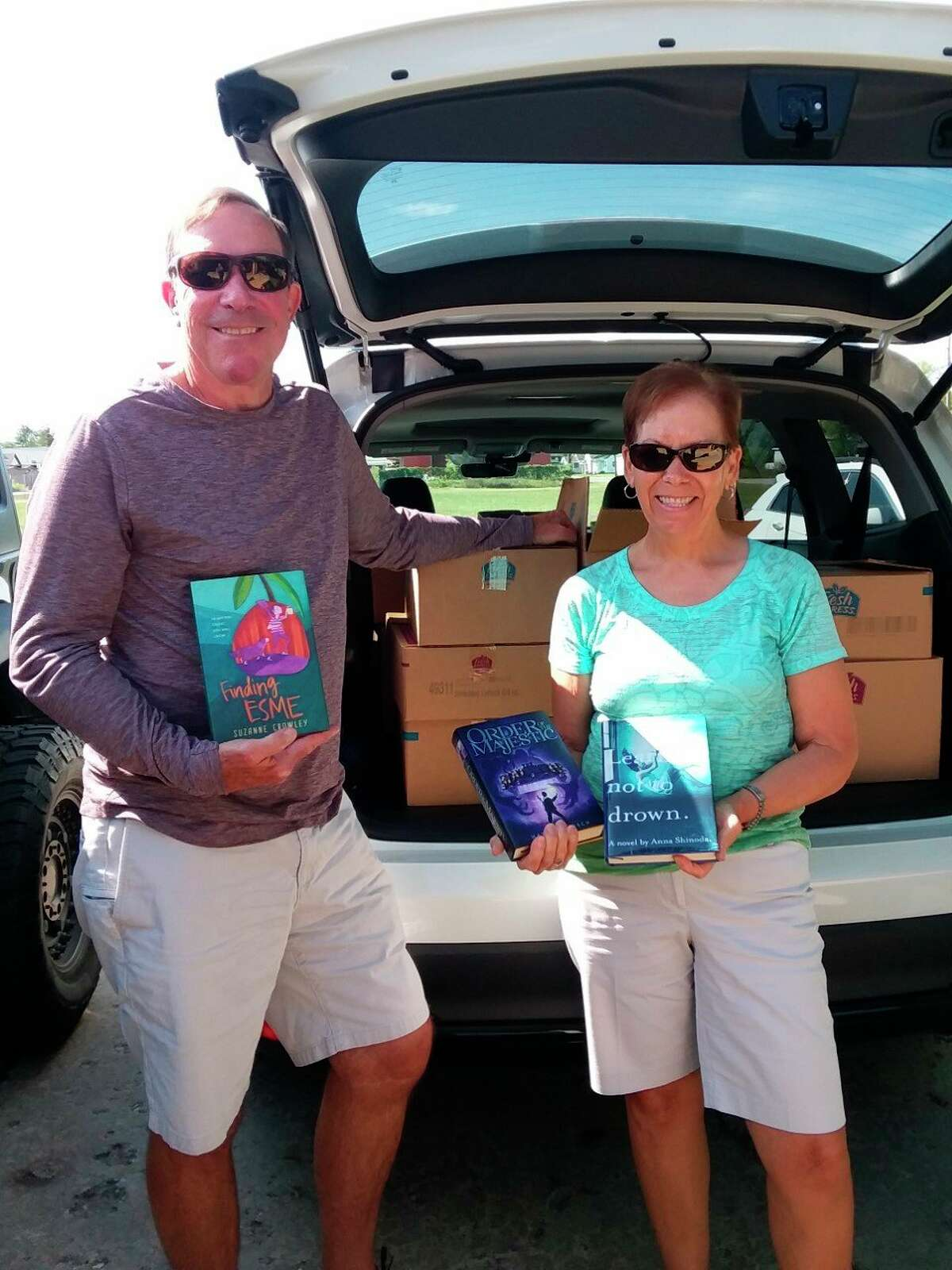 Ron and Dawn Long of Traverse City deliver book donations to the Bread of Life Pantry in Baldwin every three weeks. (Submitted photo)