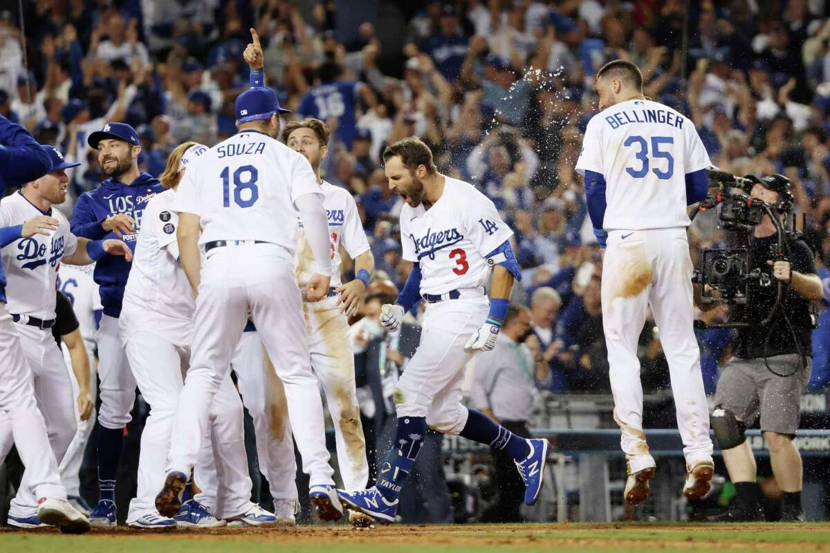 LOS ANGELES, CALIFORNIA - OCTOBER 06: Chris Taylor #3 of the Los Angeles Dodgers celebrates with teammates after his walk off two-run home run in the ninth inning to defeat the St. Louis Cardinals 3 to 1 during the National League Wild Card Game at Dodger Stadium on October 06, 2021 in Los Angeles, California. (Photo by Harry How/Getty Images)