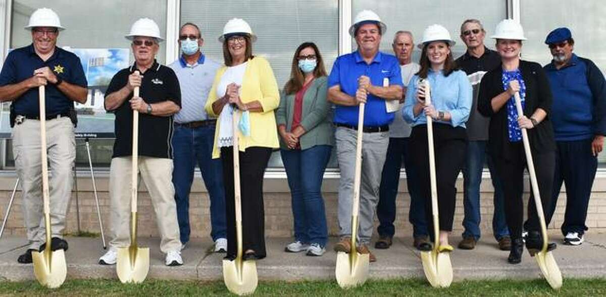 Ground was broken for a new public safety center in Carlinville on Monday. Among those attending were Carlinville Police Chief David Haley (from left), head of public safety Randy Ober, Mayor Sarah Oswald, head of finance Kim Harber, state Rep. Avery Bourne and CTS account manager Ellie Blankenship. City Council members are in the back row.