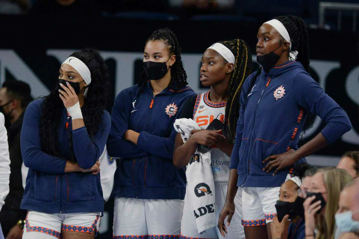 Connecticut Sun players watch during the final seconds in Game 4 of a WNBA basketball playoff semifinal against the Chicago Sky on Wednesday.