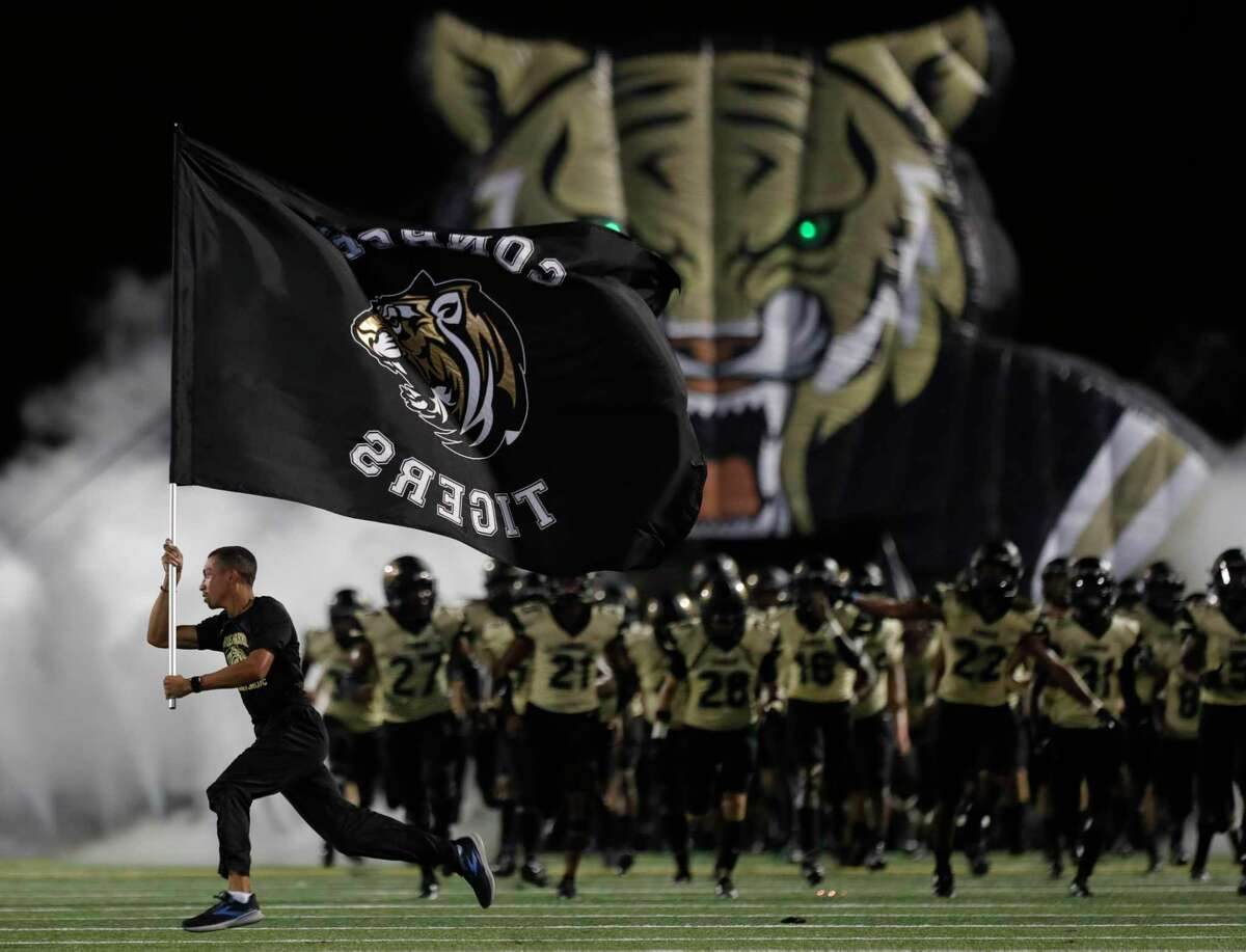 The Conroe Tigers take the field for the second half during a non-district high school football game at Buddy Moorhead Stadium, Friday, Aug. 27, 2021, in Conroe.