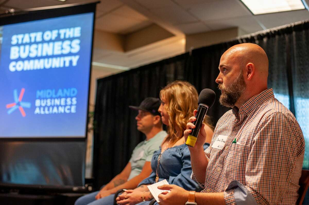 Daniel Buzzell (right), co-owner of Ace Hardware & Sports, Inc. in Midland, speaks at the Midland Business Alliance's State of the Business Community on Oct. 6, 2021, at Dow Diamond.