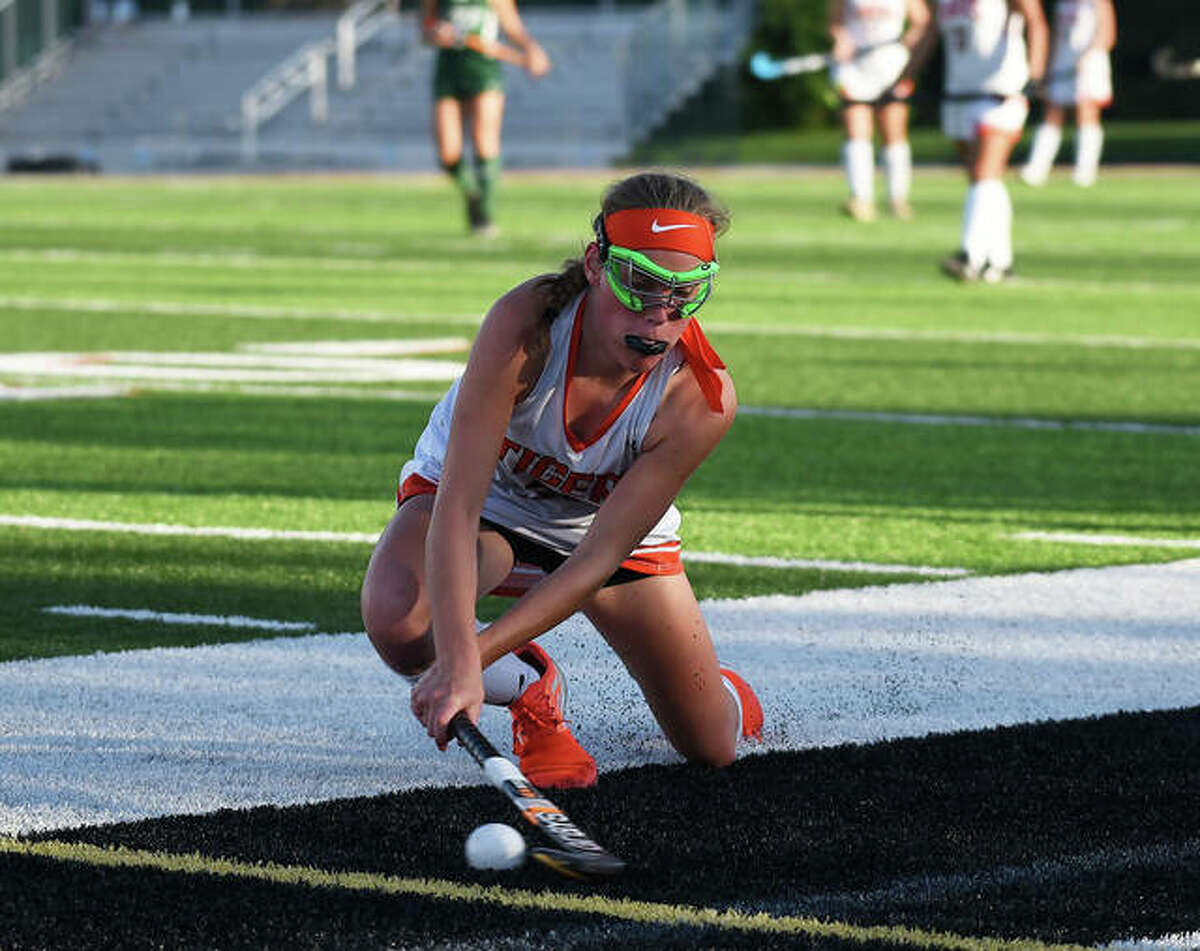 Edwardsville's Morgan Angle swipes a pass down the field during the fourth quarter.