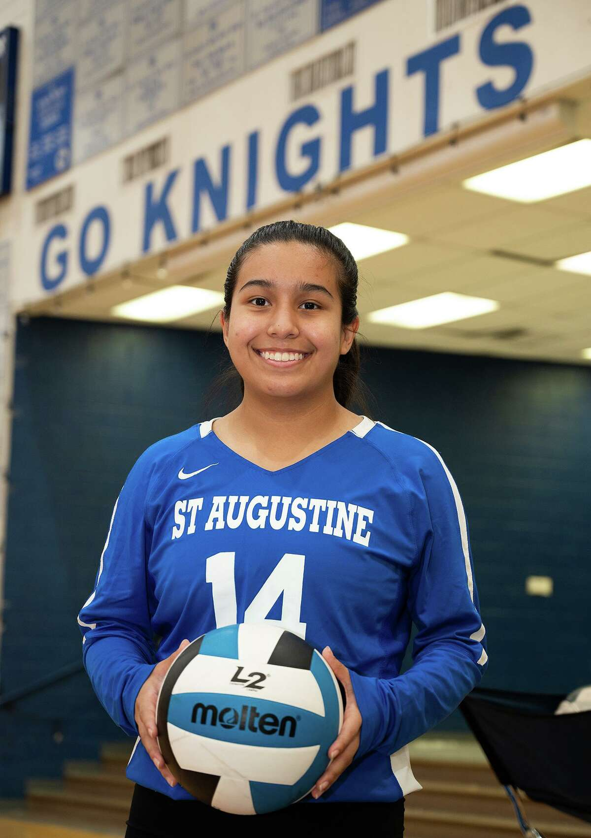 St. Augustine High School volleyball player Mia Rose Flores poses for a feature photo, Thursday, Sept. 30, 2021, at the St. Augustine High School Wellness Center.