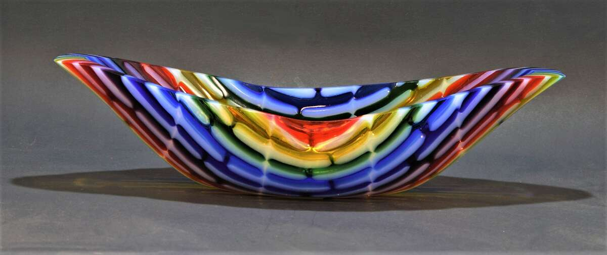Pieces like this infused glasswork designed and created by artist Mary Torres highlight the 24th annual ARToberFEST Oct. 16-17 in Galveston's historic downtown cultural arts district. Visit www.artoberfest.com for details.
