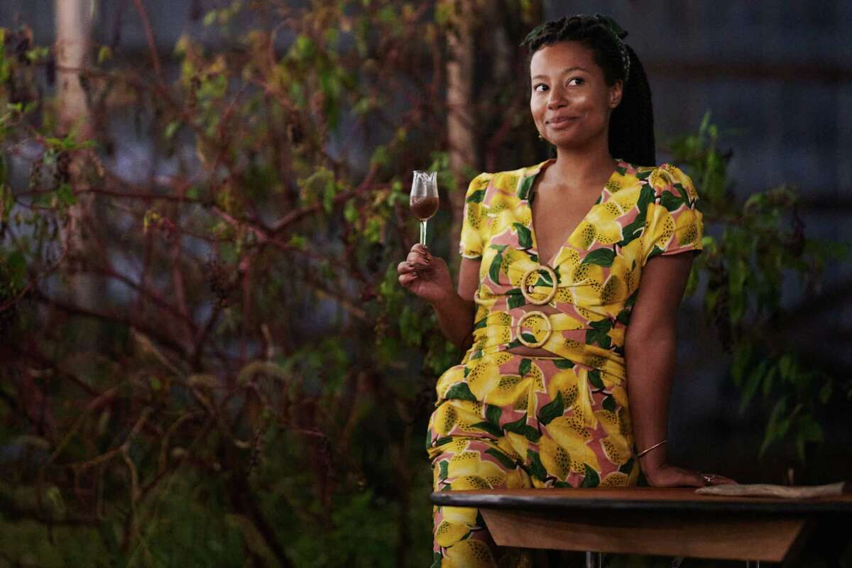 Gabrielle Carter toasts to her guests and team with Andrew Lee's muscadine wine, at the end of an outdoor dinner she hosted in North Carolina.