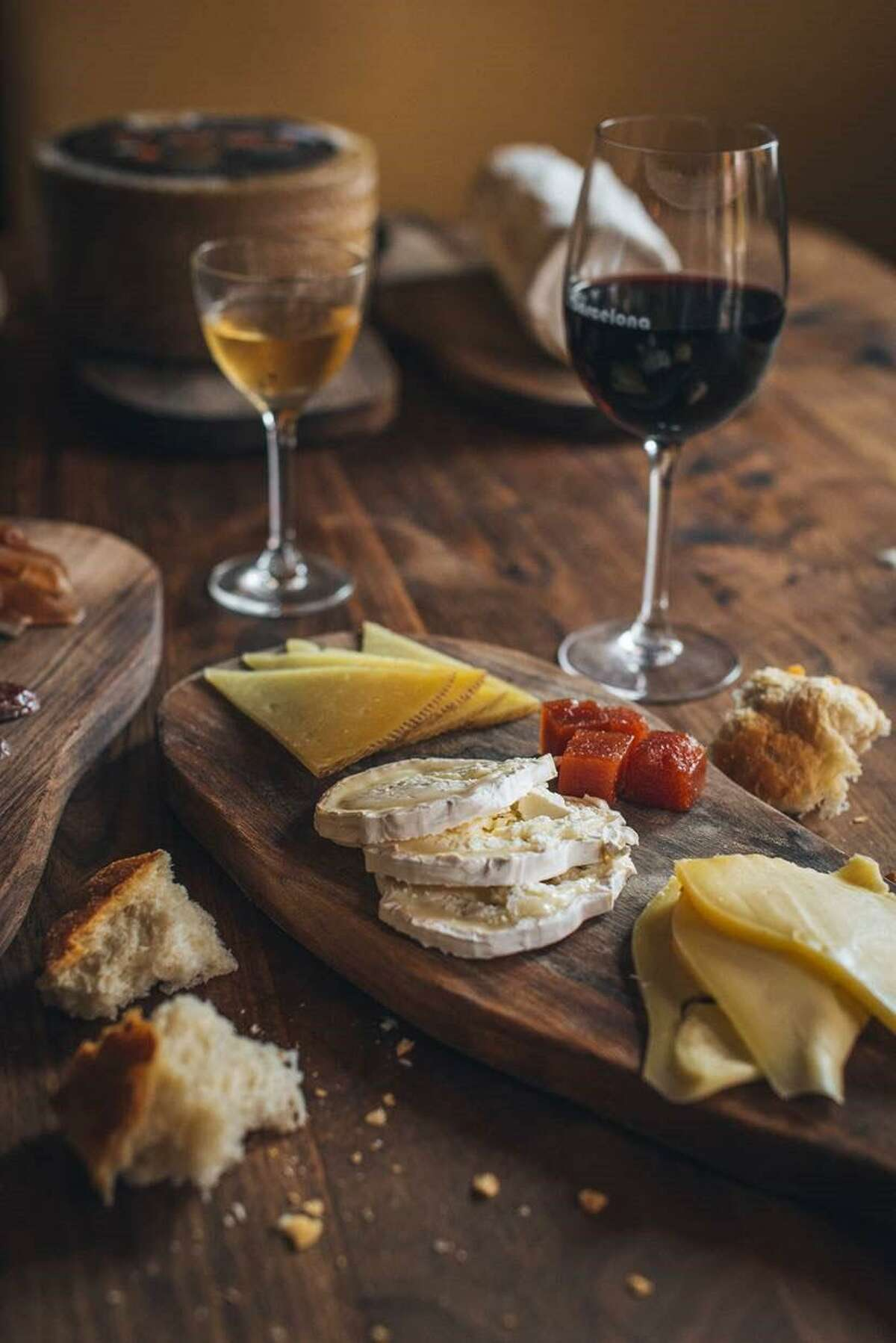 A section of cheeses along with a glass of sherry and a glass of red wine at Barcelona in Fairfield.