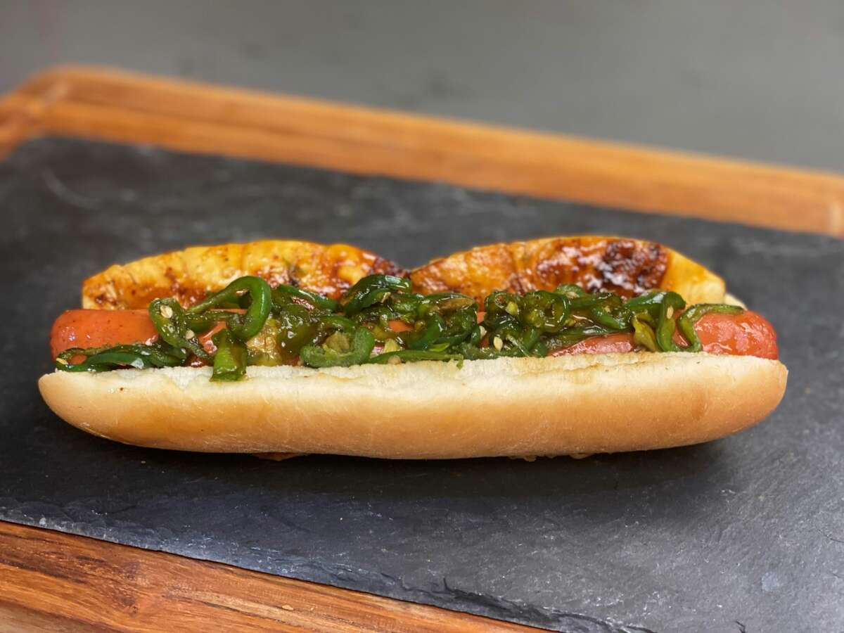 The Piña Dog at Minute Maid Park, a grilled beef hot dog topped with smoked pineapple and candied jalapeños.