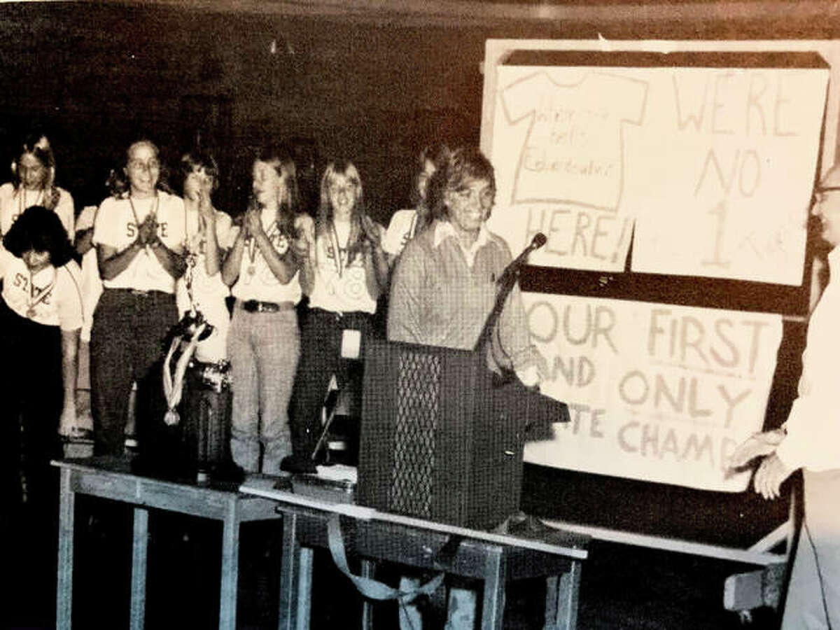 Edwardsville coach Sharon Petty, right, with the 1978 EHS field hockey team after the Tigers won the first state championship in school history.