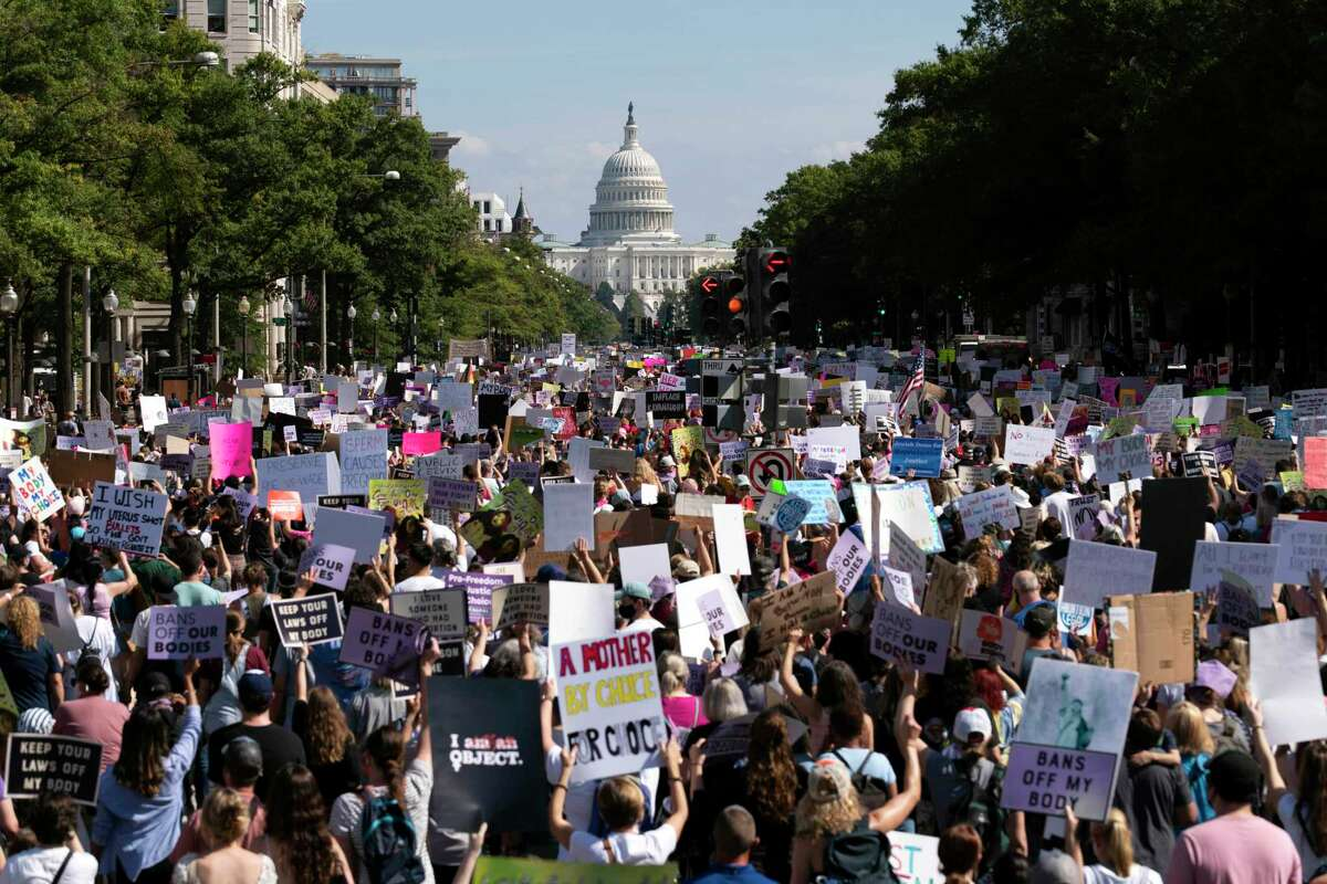 With the U.S. Capitol in the background, thousands of demonstrators march on Pennsylvania Avenue during the Women's March in Washington Saturday.