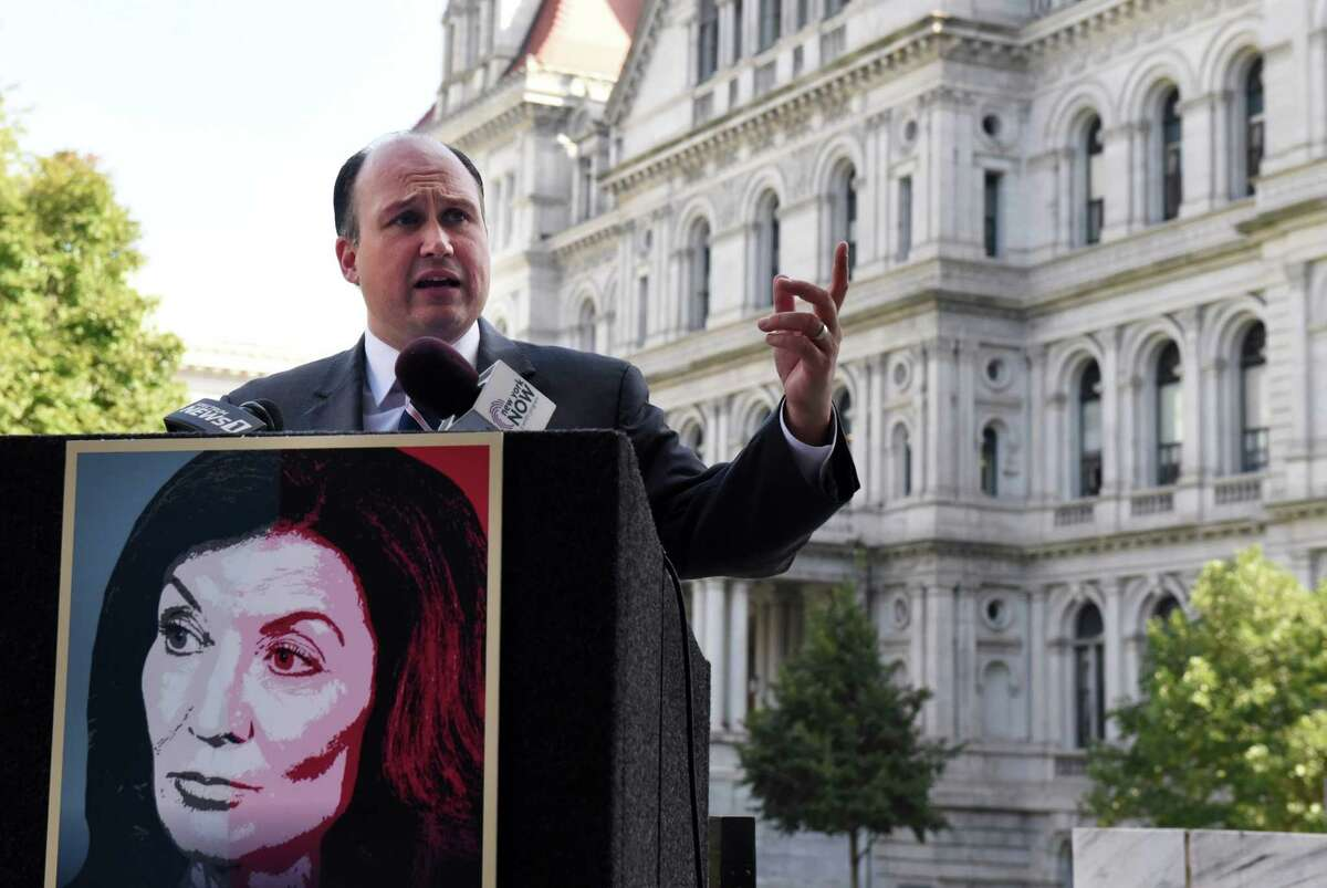 New York Republican Chairman Nick Langworthy calls on Gov. Kathy Hochul to fire all of former Gov. Andrew M. Cuomo's staffers who played a role in the COVID-19 nursing home scandal on Thursday, Oct. 7, 2021, outside the Legislative Office Building in Albany, N.Y.