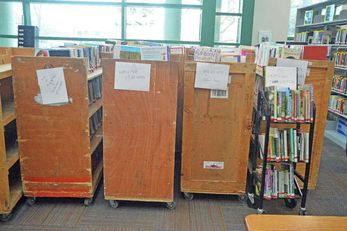 """FILE - These are some of the books being moved as part of """"EPL - The Next Chapter,"""" which will involve the renovation and modernization of the interior of the Edwardsville Public Library."""