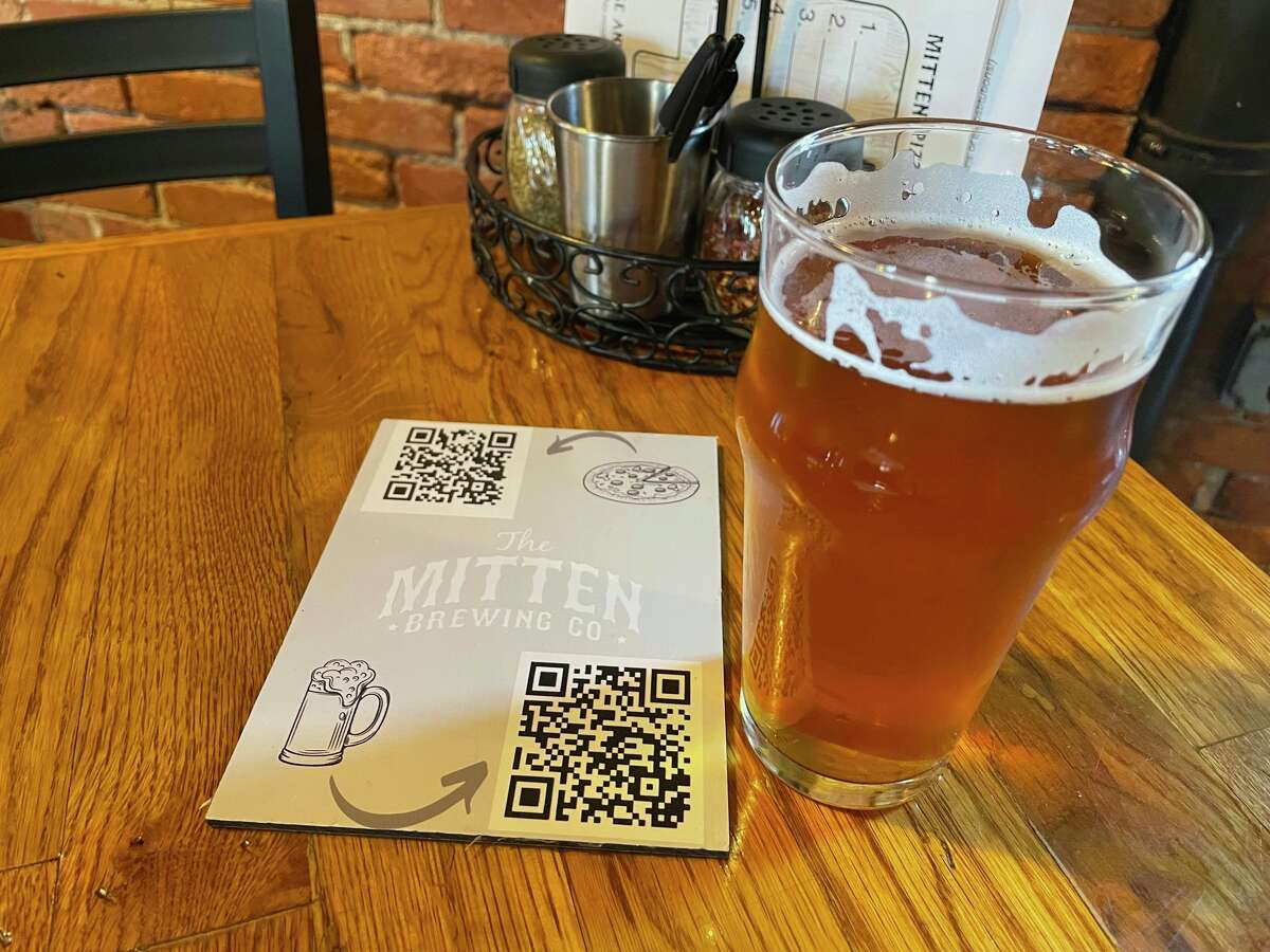 Flagship beers at The Mitten include Country Strong IPA (shown here), Peanuts and Cracker Jacks ale, and Triple Crown Brown, a 2016 World Beer Cup Silver Medalist. (Amy Sherman/For Hearst Midwest)