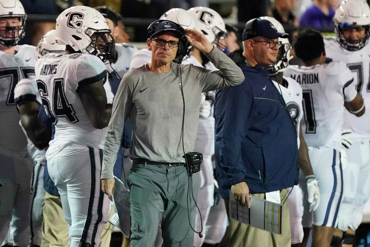 UConn coach Lou Spanos watches from the sideline during Saturday's loss at Vanderbilt in Nashville.