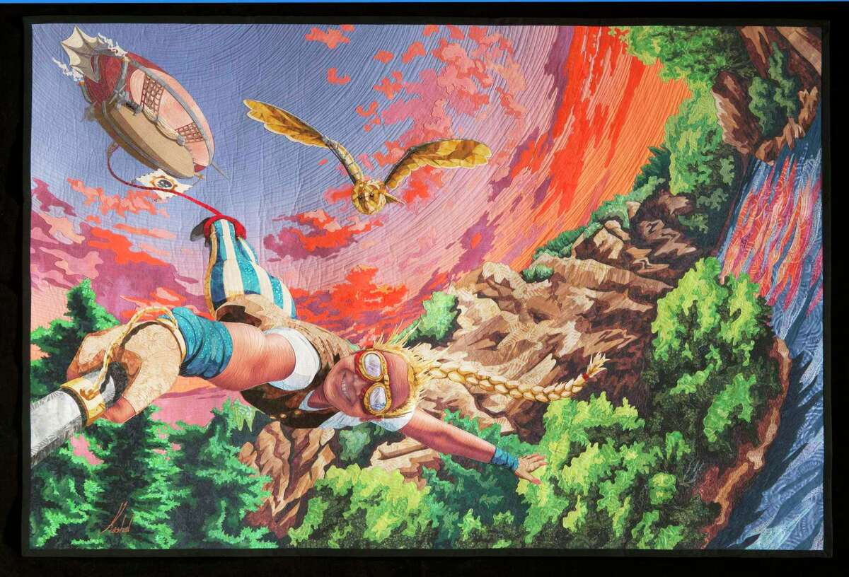 """The equilter.com Master Award for Contemporary Art award, and a $5,000 prize, went to Kestrel Michaud of West Melbourne, Fla. Her """"Leap of Faith"""" quilt carried a Steampunk fantasy theme, including hot-air ships, bungee jumping and a pet owl, all in vivid hues."""