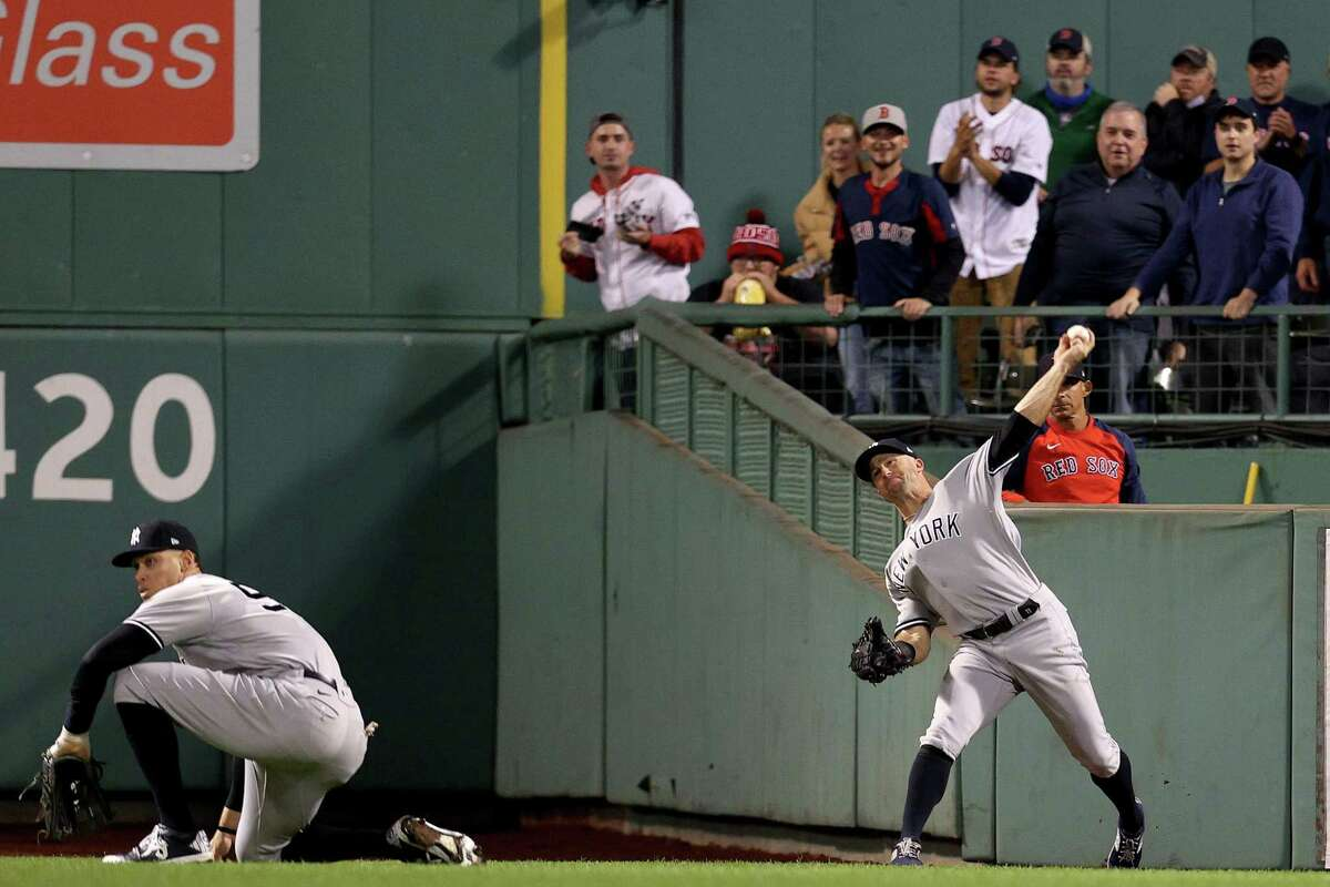 Brett Gardner of the New York Yankees throws to second base against the Boston Red Sox during the second inning of the American League Wild Card game at Fenway Park on Tuesday.