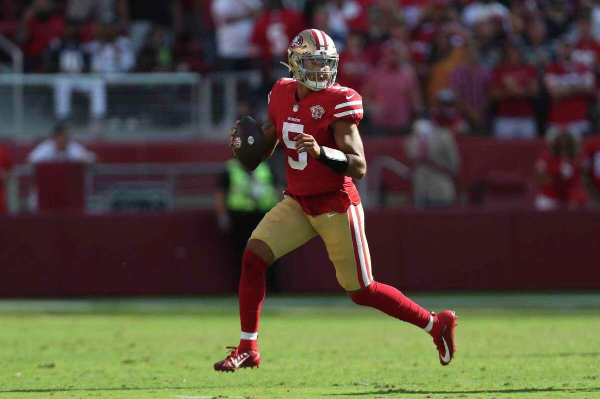 San Francisco 49ers quarterback Trey Lance (5) against the Seattle Seahawks during an NFL football game in Santa Clara, Calif., Sunday, Oct. 3, 2021. (AP Photo/Jed Jacobsohn)