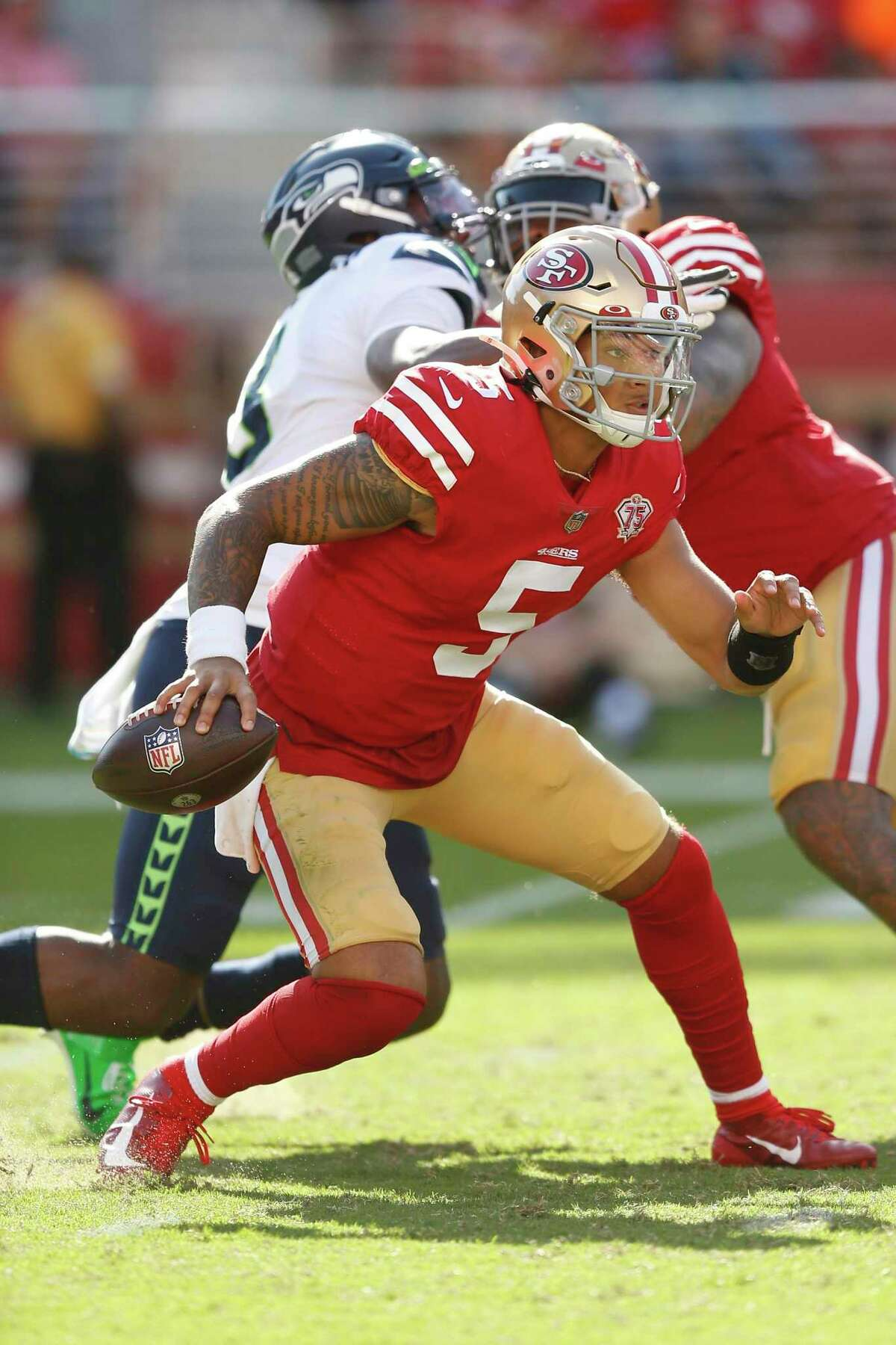 San Francisco 49ers quarterback Trey Lance (5) runs with the ball against the Seattle Seahawks during an NFL football game, Sunday, Oct. 3, 2021 in Santa Clara, Calif. (AP Photo/Lachlan Cunningham)