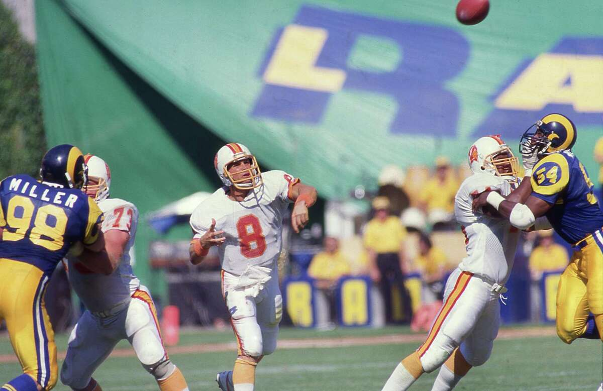 ANAHEIM, CA: Steve Young of the Tampa Bay Buccaneers circa 1986 passes against the Los Angeles Rams at Anaheim Stadium in Anaheim, Califrnia. (Photo by Owen C. Shaw/Getty Images)