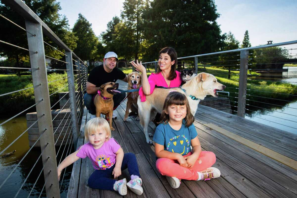 KPRC 2 anchor Lisa Hernandez and her family, including four dogs.