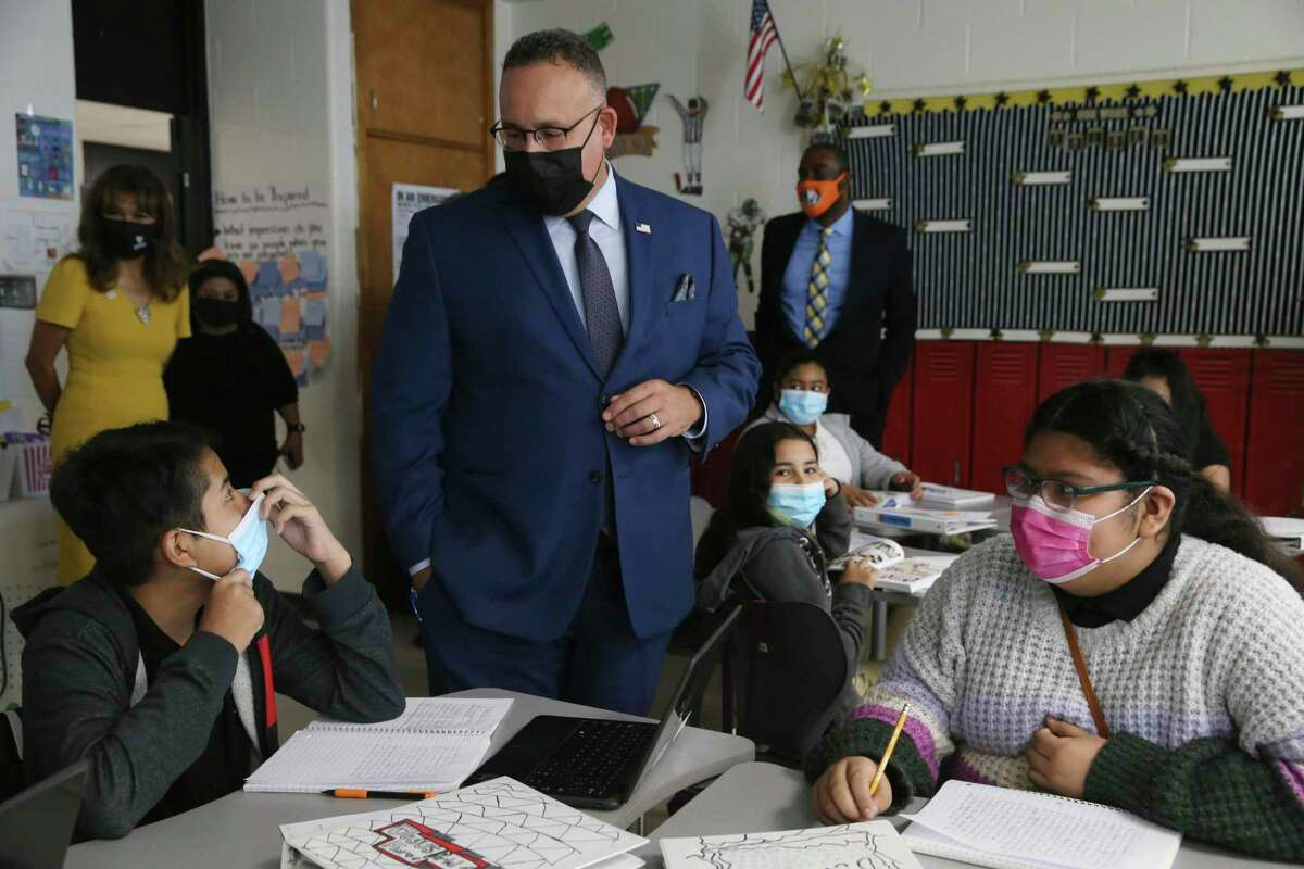 U.S. Secretary of Education Miguel Cardona visits with students in Kimberly Nwosu's sixth-grade class at Gus Garcia University School in Edgewood ISD on Thursday, Oct. 7, 2021. With Cardona was U.S. Rep. Joaquin Castro. Cardona visited three classrooms and met with a panel of students before holding a press conference. It was his second stop in the two-day Texas visit pushing the administration's Build Back Better campaign.
