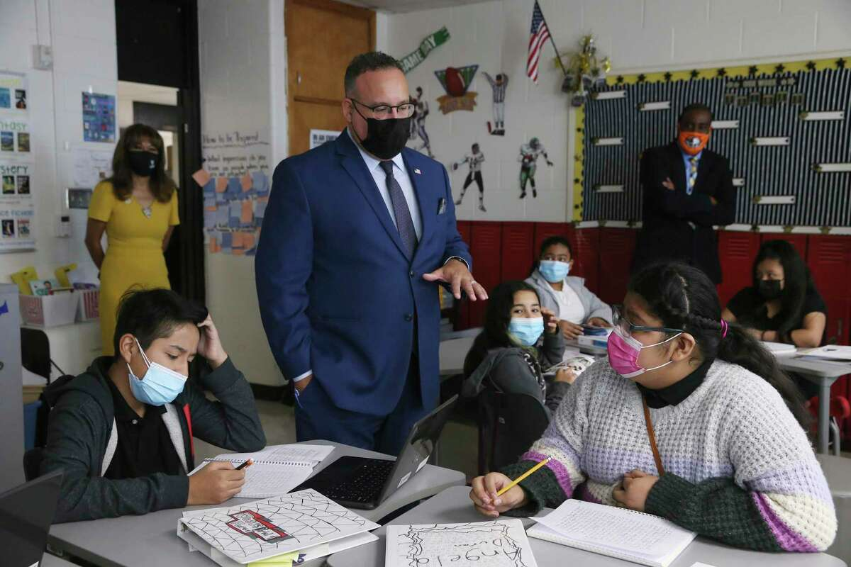 U.S. Secretary of Education Miguel Cardona visits with students in Kimberly Nwosu's sixth-grade class at Gus Garcia University School in Edgewood ISD, Thursday, Oct. 7, 2021. With Cardona was U.S. Rep. Joaquin Castro. Cardona visited three classrooms and met with a panel of students before holding a press conference. It was his second stop in the two-day Texas visit pushing the administration's Build Back Better campaign.