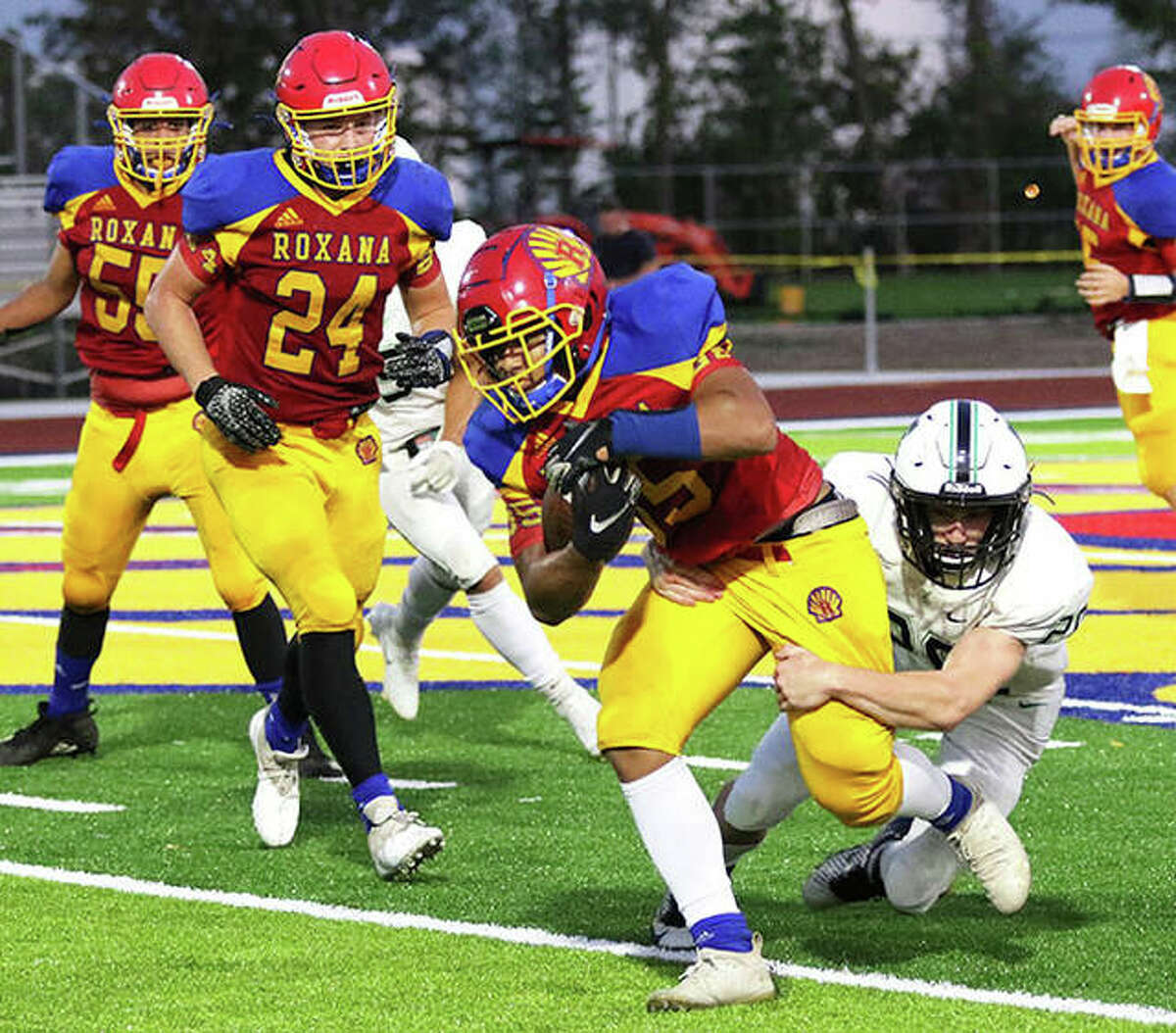 Roxana RB Terrel Graves tries to run through a tackle from a Eureka defender during a Week 1 game at Raich Field in Roxana. The Shells are back home Friday for a Cahokia Conference game vs. Breese Central.
