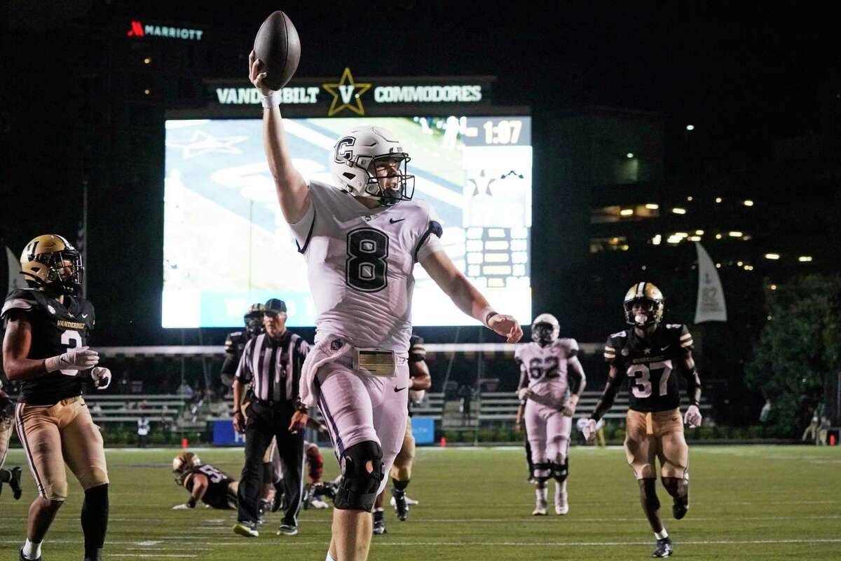 Connecticut quarterback Steven Krajewski (8) scores a touchdown on a 17-yard run against Vanderbilt in the second half of an NCAA college football game Saturday, Oct. 2, 2021, in Nashville, Tenn. (AP Photo/Mark Humphrey)