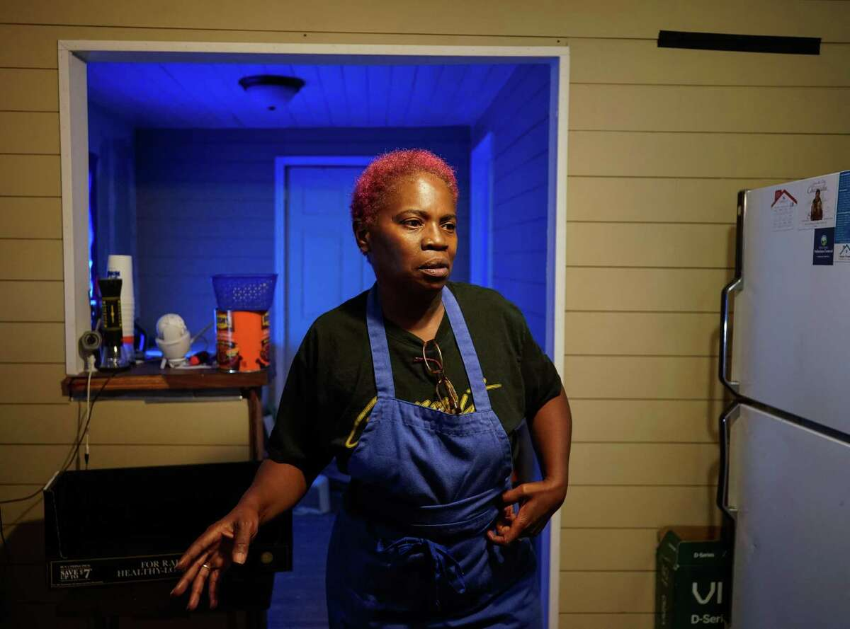 Sandra Edwards talked about not being done repairing her home from damage caused by Hurricane Harvey while standing in her kitchen on Wednesday, Oct. 6, 2021, in Fifth Ward. Edwards decided to host a barbecue at her house in an effort to raise money. Her is located in the polluted site near Union Pacific's railway station.