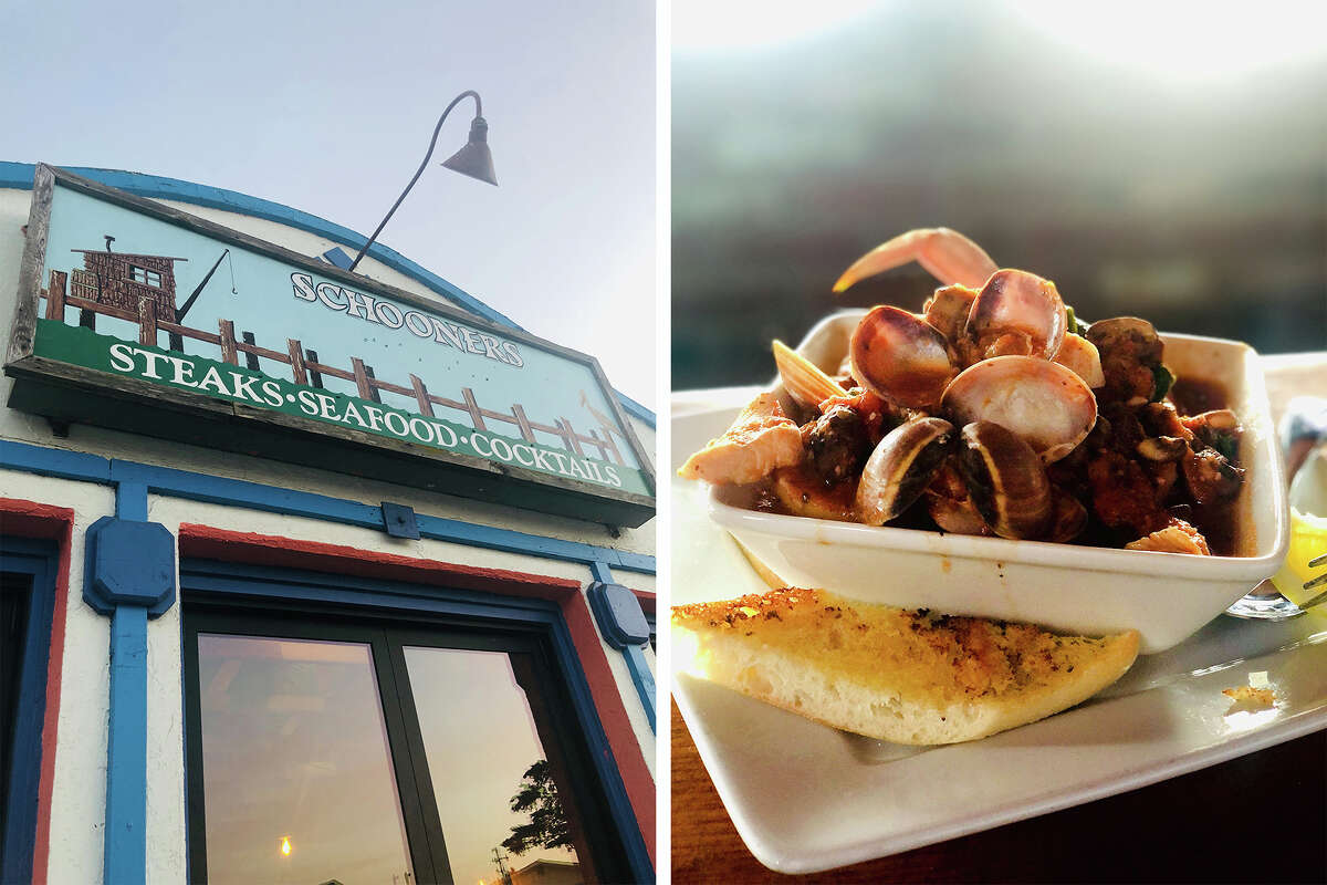 Left: Outside at Schooner's, a rustic seafood restaurant on the beach. Right: Spicy cioppino at Schooner's.