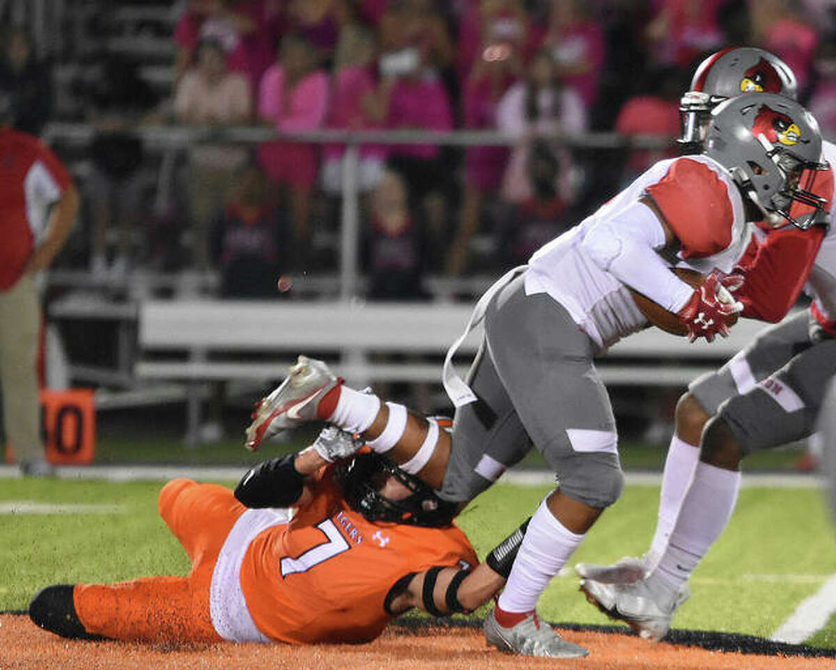 Edwardsville linebacker Chase Parker trips up the Alton ball carrier in the first half on Friday in Edwardsville.