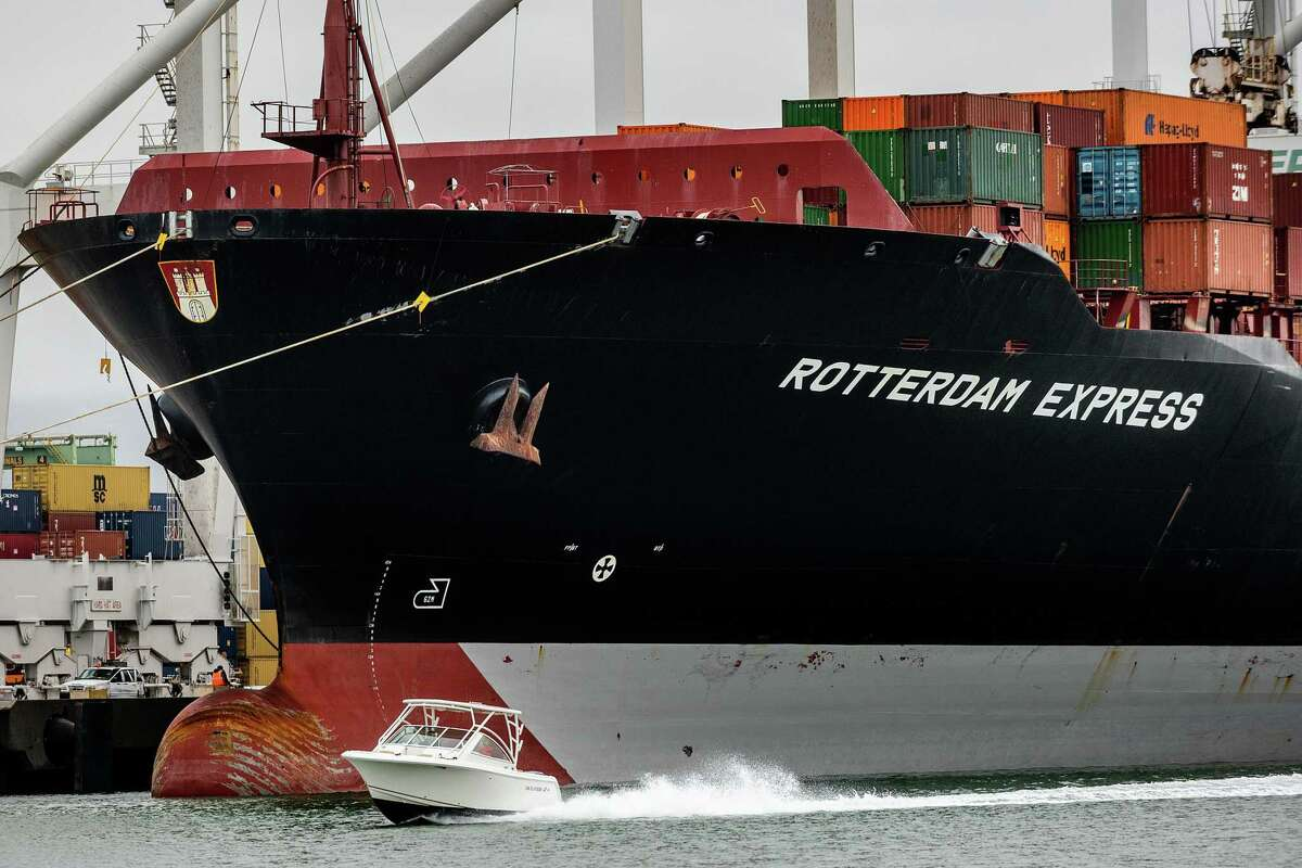 A boat passes the Rotterdam Express, which arrived from Orange County, on Wednesday, Oct. 6, 2021, in Oakland, Calif.