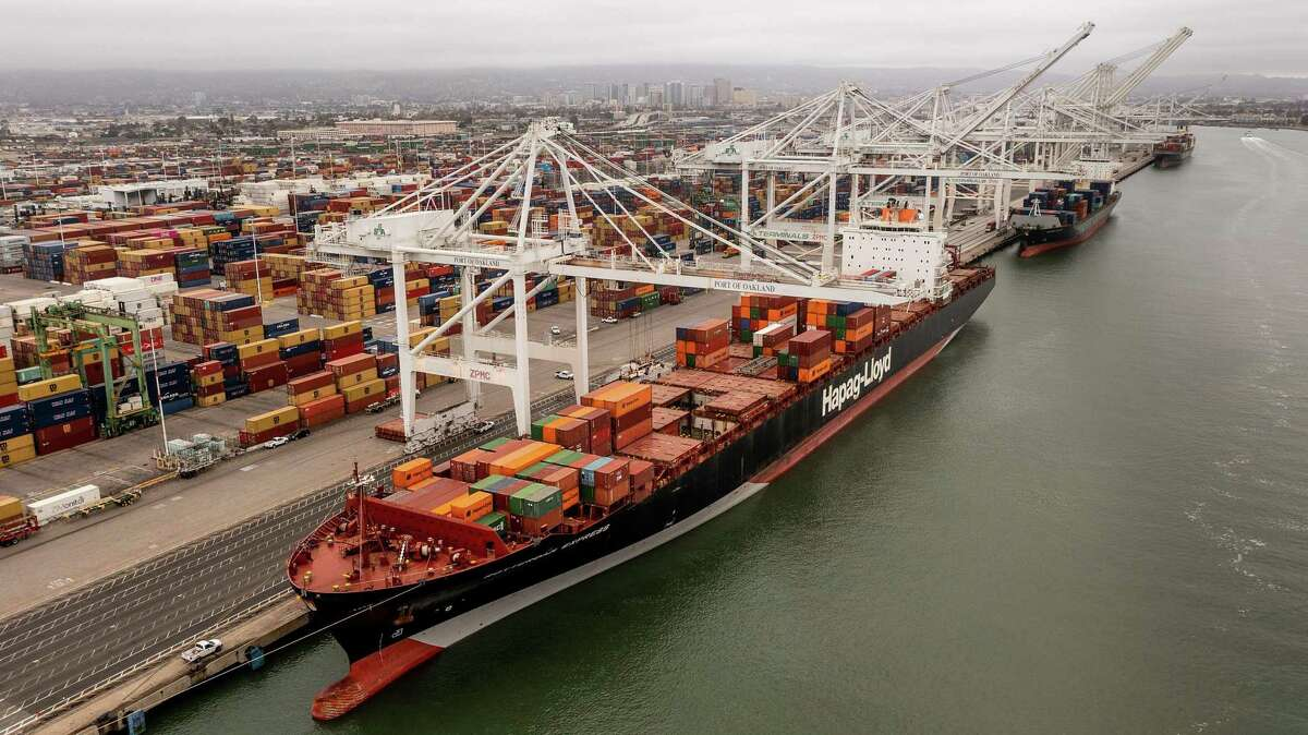 The Rotterdam Express unloads containers in Oakland, Calif., after arriving from Orange County on Wednesday, Oct. 6, 2021.