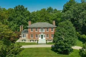 Whether or not British Gen. John Burgoyne actually stayed at this circa-1765 mansion at  24 Broad St., Kinderhook  as the marker out front proclaims, this place oozes history. Built for David Van Schaack, a member of a powerful Dutch family with deep ties in Kinderhook and Columbia County, the Georgian manor home has 5,796 square feet of living space, four bedrooms and three and a half bathrooms. The wings were added in the early 19th century. The house has been beautifully maintained and decorated by its current owners, a pair of antiques dealers. The couple bought the house in 2005 as a summer home and made it their primary residence in 2013. Four of the fireplaces are operable and there are deep window seats, an abundance of gorgeous woodwork and a modern kitchen. List price: $2,950,000. Taxes: $29,000. Contact listing agent Andrew Gates of Houlihan Lawrence at 917-755-2640.