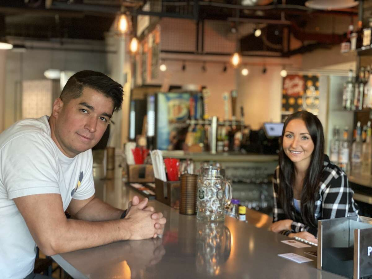 Dave Camacho and Hannah Van Buren, co-owners of The Fox and the Burn, a new bar in Troy.