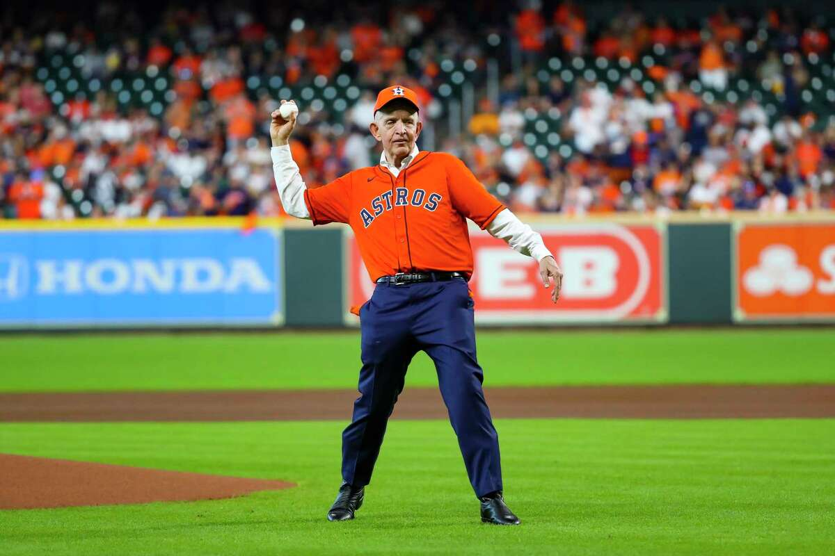 """Jim """"Mattress Mack"""" McIngvale throws out the ceremonial first pitch before Game 1 of the AL Division Series Thursday, Oct. 7, 2021, in Houston."""