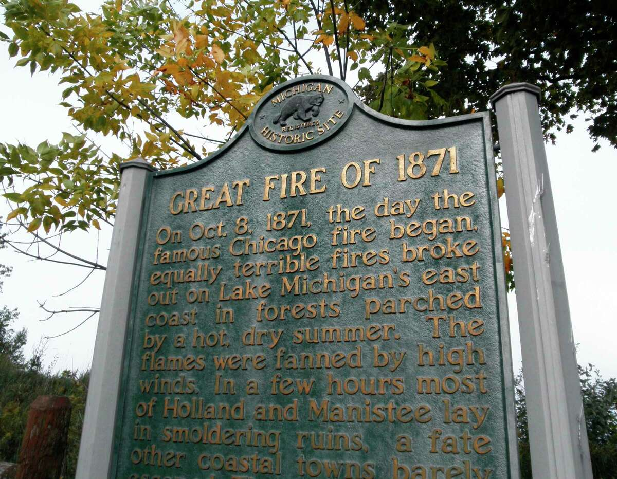 Manistee's Great Fire of 1871 is summarized in the State Register of Historic Sites sign that stands at Orchard Beach State Park.(Manistee County Historical Museum photo)